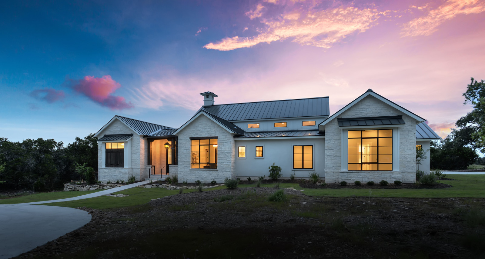 Boerne Custom Home - Front Elevation Modern Farmhouse Sunset