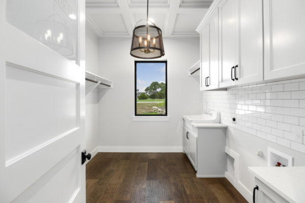 Boerne Custom Home - Modern Farmhouse White Utility Room