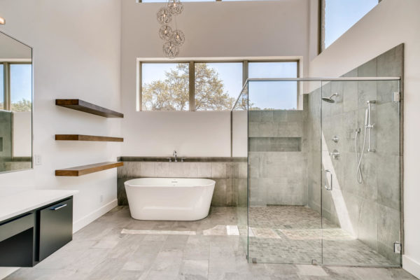 San Antonio Custom Home - Tub and glass Shower