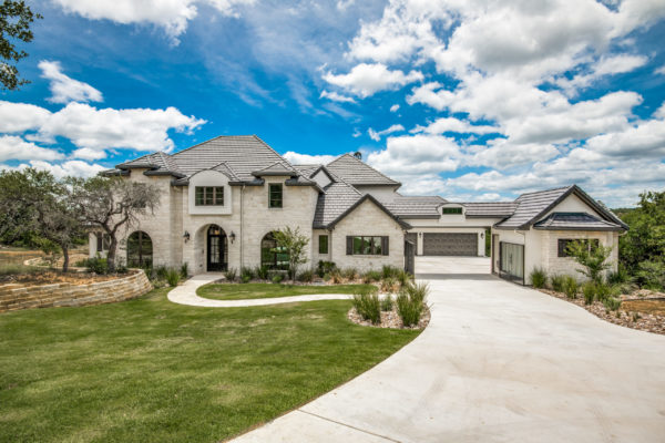 Boerne Custom Home - White Limestone Exterior and gray roof