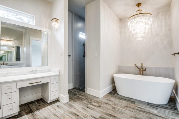 Boerne Custom Home - Master Bathroom with Chandelier over White Bath Tub