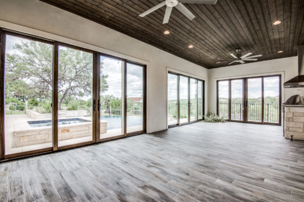 Boerne Custom Home - Game Room with Glass Windows