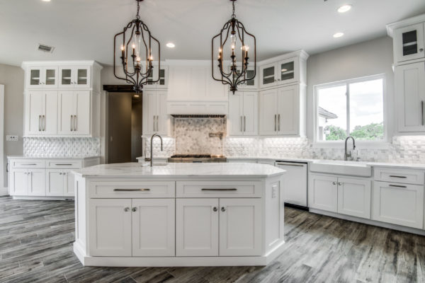 Boerne Custom Home - Kitchen with Gray Wood Floors